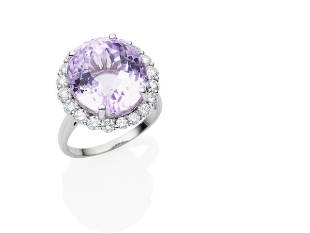 A kunzite and diamond ring