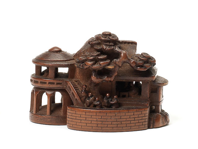 A wood netsuke of a rural retreat By Horaku, 19th century