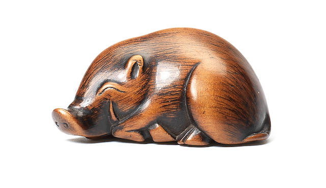 A boxwood netsuke of a wild boar Early 19th century