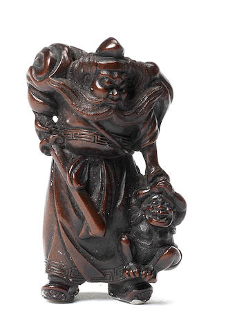 A wood netsuke of a shoki and oni By Ryukosai Jugyoku, Edo, 19th century