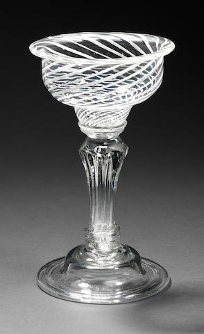 A rare panel moulded stem sweetmeat glass, circa 1750
