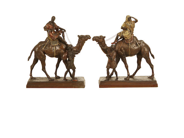 After Charles Valton, French (1851-1918) A pair of cold painted spelter figures of Arabs with camels