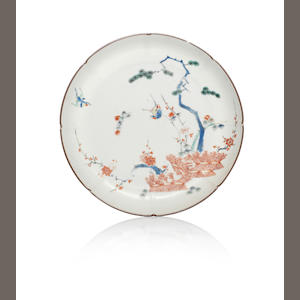 A Kakiemon dish, painted with bird, prunus, pine and banded hedge, Christie's London, 5/6.6.1990