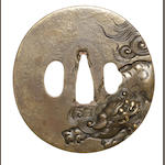 A brass tsuba Attributed to Ichinomiya Nagatsune, 1772-1787