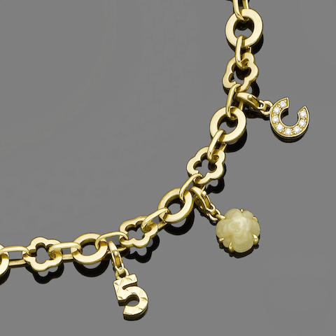 A gold charm bracelet and necklace, by Chanel (2) (partially illustrated)