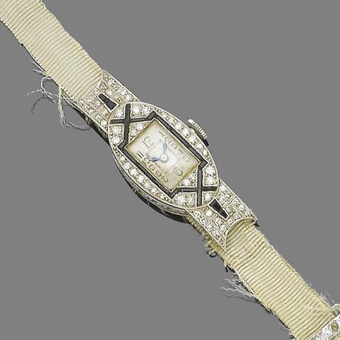 An Art Deco onyx and diamond wristwatch,