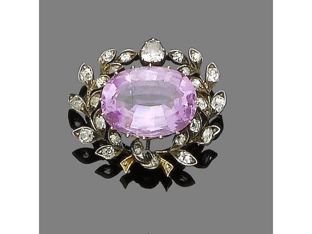 A pink topaz and diamond brooch,