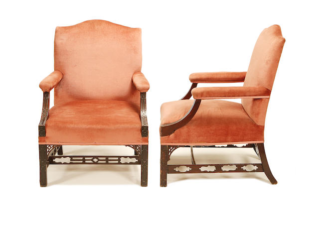 A pair of late Victorian mahogany 'Gainsborough' armchairs in the Chippendale style