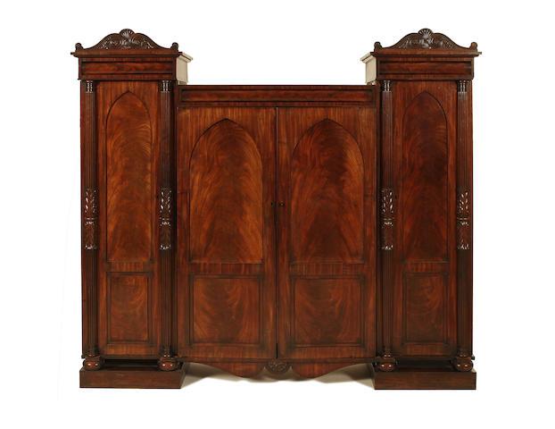 A George IV mahogany triple wardrobe