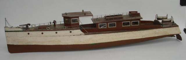 A wooden pond model of a boat