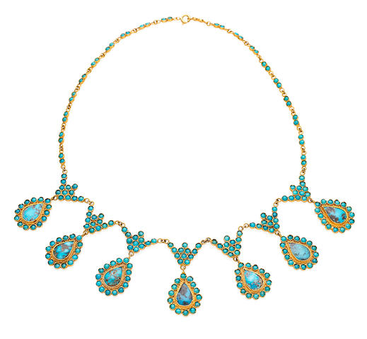 A gold and turquoise suite
