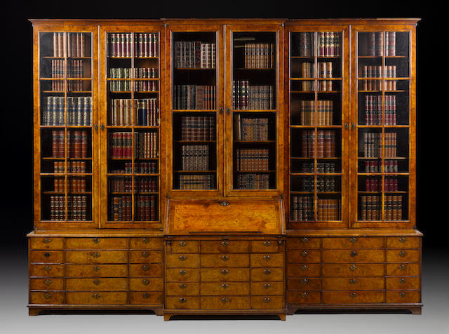 A George I walnut combined breakfront library bookcase and bureau bookcase attributed to Peter Miller