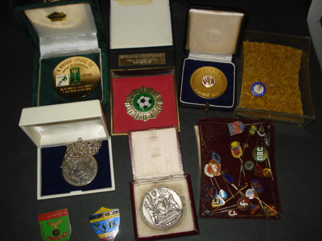 Various medals and badges presented to Ray Wood