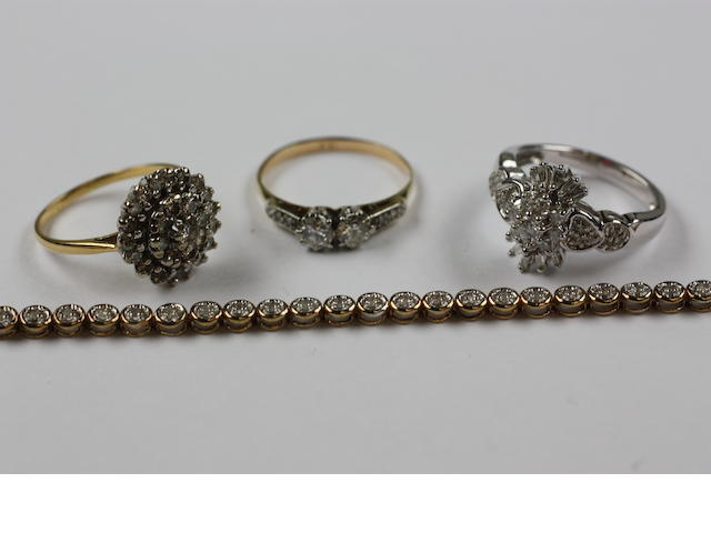 Three diamond rings and a diamond tennis bracelet, (4)