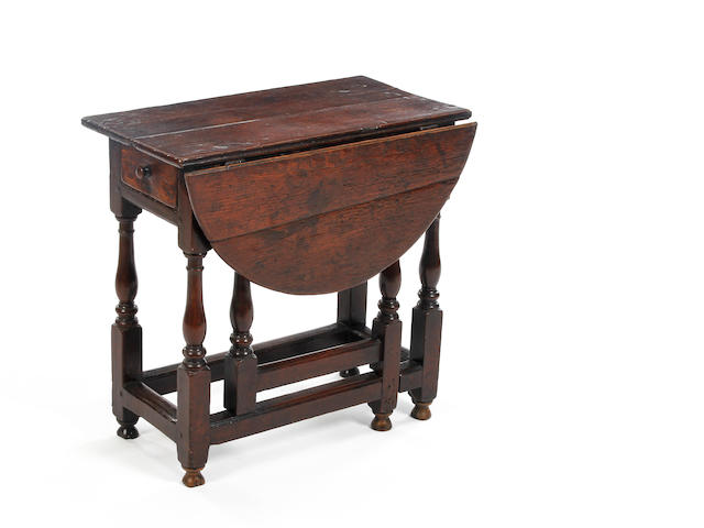 An oak single drop-leaf gateleg occasional tableCirca 1710