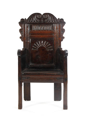 A mid-17th Century oak panel back enclosed armchairNorth Country