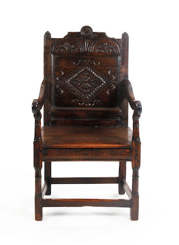 A Charles II oak panel back armchairNorth Country