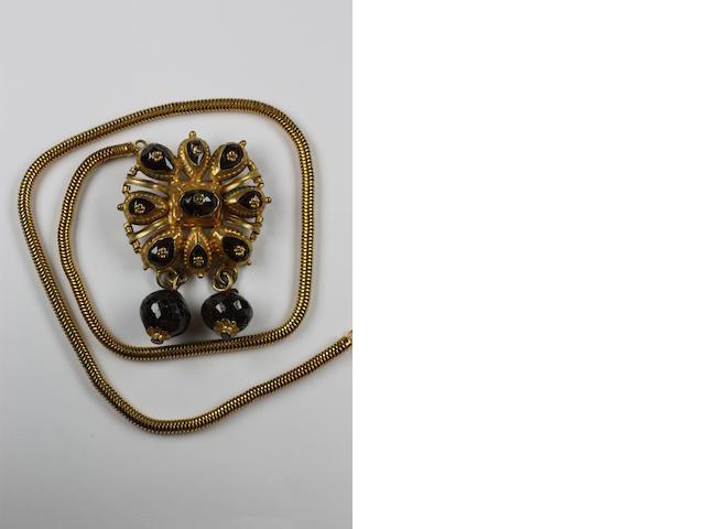 A large silver gilt garnet brooch/pendant