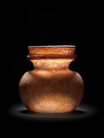 A Roman aubergine glass storage jar