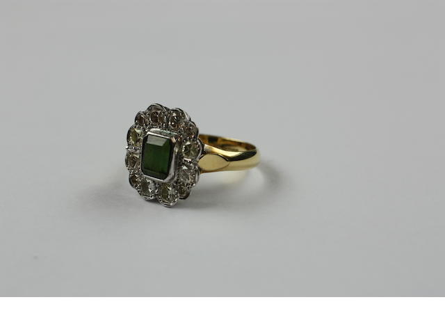An 18ct gold green tourmaline and diamond cluster ring,