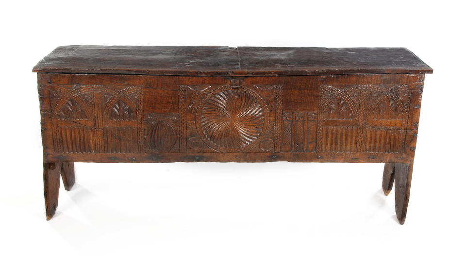 An exceptionally rare carved oak boarded chest, circa 1500.