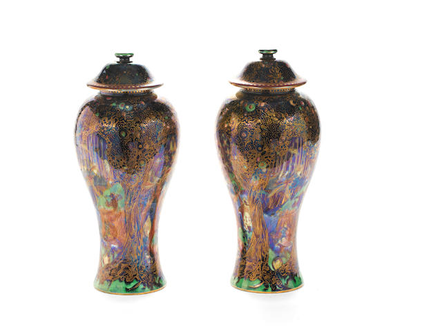 A pair of Fairyland lustre baluster vases and covers, one cover damaged