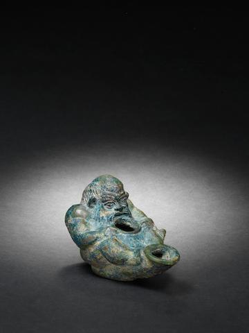A Roman bronze oil lamp