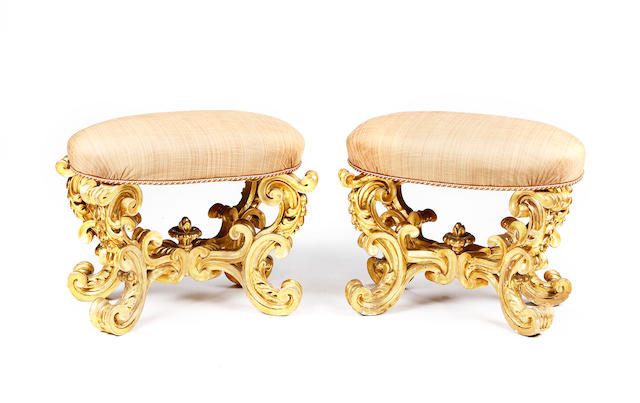 A pair of Italian mid 19th century giltwood stools in the Rococo revival style