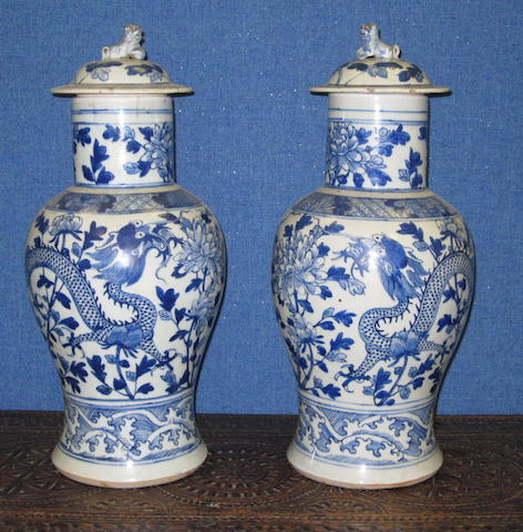 A pair of lae 19th Century Chinese blue and white porcelain baluster vases and covers