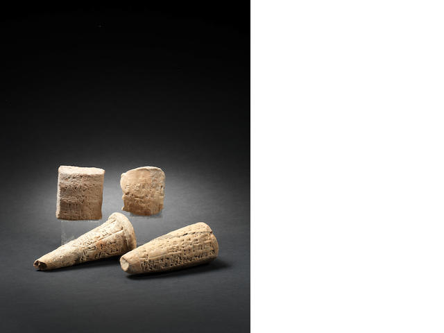 Two cuneiform fundation cones, a cuneiform tablet and a cuneiform clay envelope 4