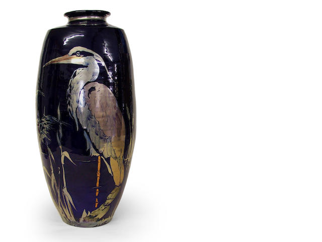 Slim vase decorated with heron and reeds in silver and copper lustre on a dark blue ground, no. to base 4761, 45cm high