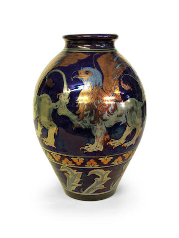 Round vase decorated with four griffins in copper, silver and mixed lustre on a blue/purple ground, no. to base 4768, 33cm high