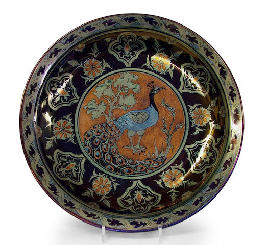 Charger decorated with a peacock in a decorated well and border in copper, silver and mixed lustre on a blue ground, no. 4656, 43.5 diam