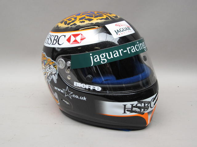 A replica Eddie Irvine helmet by Bieffe of Italy,