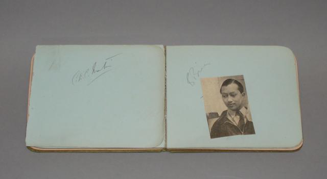 An autograph album of motor racing signatures, from the Healey family collection,