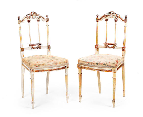 A set of four French late 19th century painted salon chairs