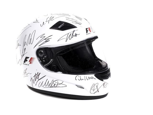 A 2011 F1 season signed helmet,