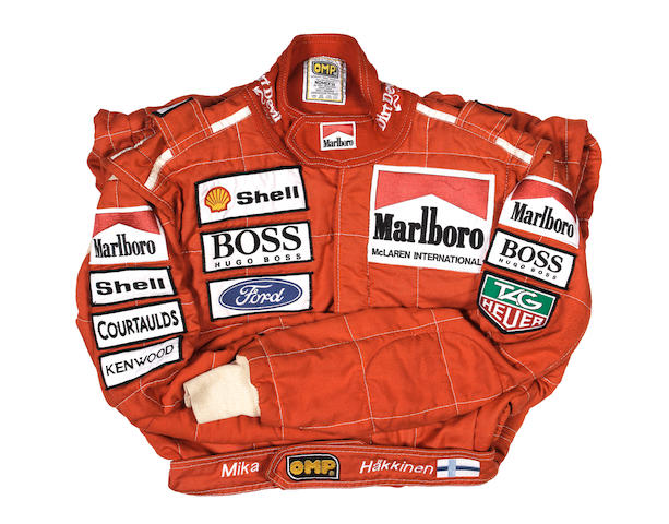 A Mika Hakkinen race suit by OMP, used during the 1993 Formula 1 season,