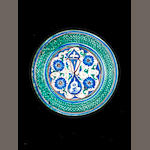 A boukhara glazed dish, 19th century, D.30,5cm, 1 repair