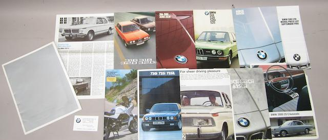 A collection of BMW brochures for various models,