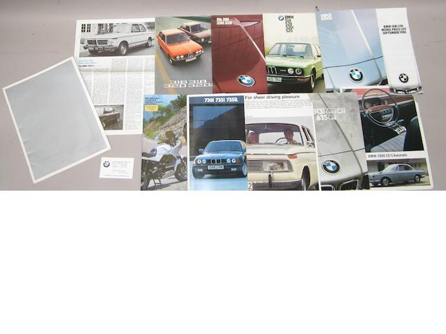 A collection of BMW brochures for various models