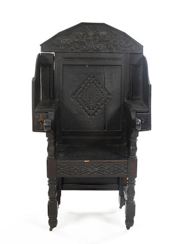 A Charles II and later oak panel back open armchair Adaptations