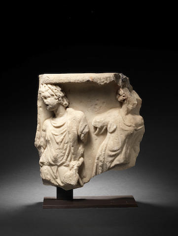 Roman marble relief fragment with two figures