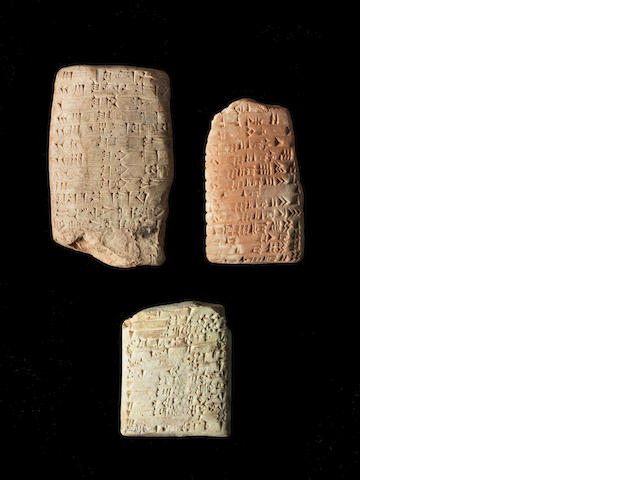 Three larger cuneiform tablets