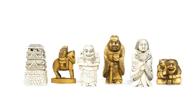 An ivory netsuke chess set, Japanese, late 19th/early 20th century,