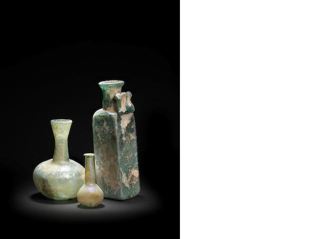 A group of three Roman glass vessels