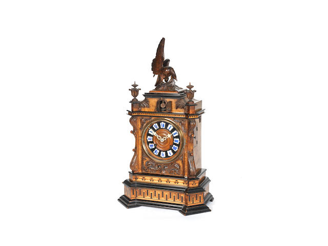 An early 20th century German Black Forest burr walnut mantel cuckoo clock  Retailed by Wehrile Brothers 47 Warwick Street Kilburn