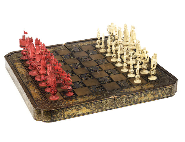 """A Chinese Export ivory """"puzzleball"""" figural chess set, Canton, early 19th century,"""