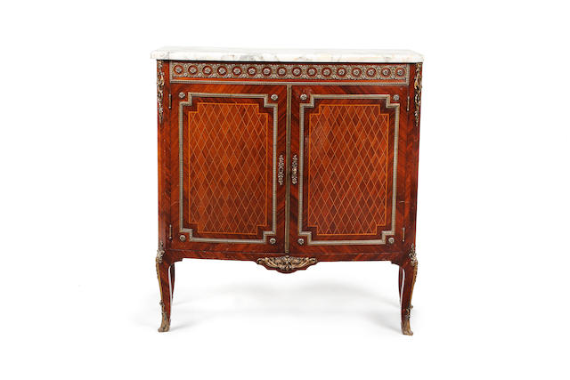 A French early 20th century brass mounted kingwood and parquetry bowfront side cabinet in the Transitional style