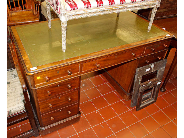 A 19th Century mahogany twin pedestal desk,fitted with nine drawers on plinth base, 138cm wide